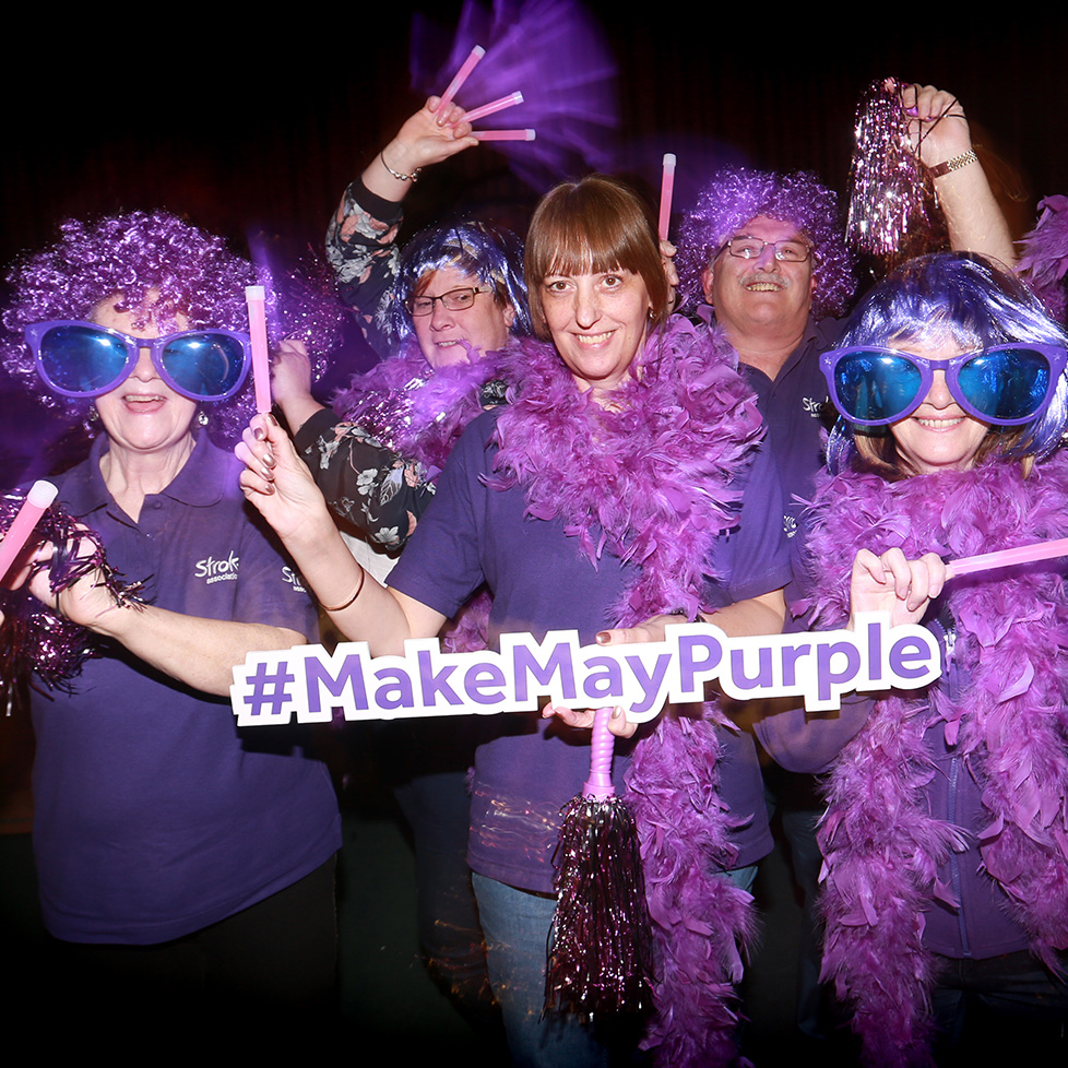 A group of ladies celebrate Make May Purple