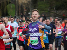 Stroke Association runner giving a thumbs up at a sporting event