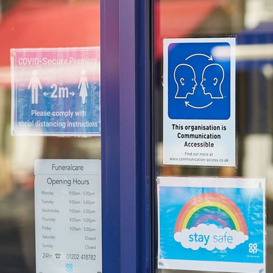 Shop displaying the Communication Access Symbol