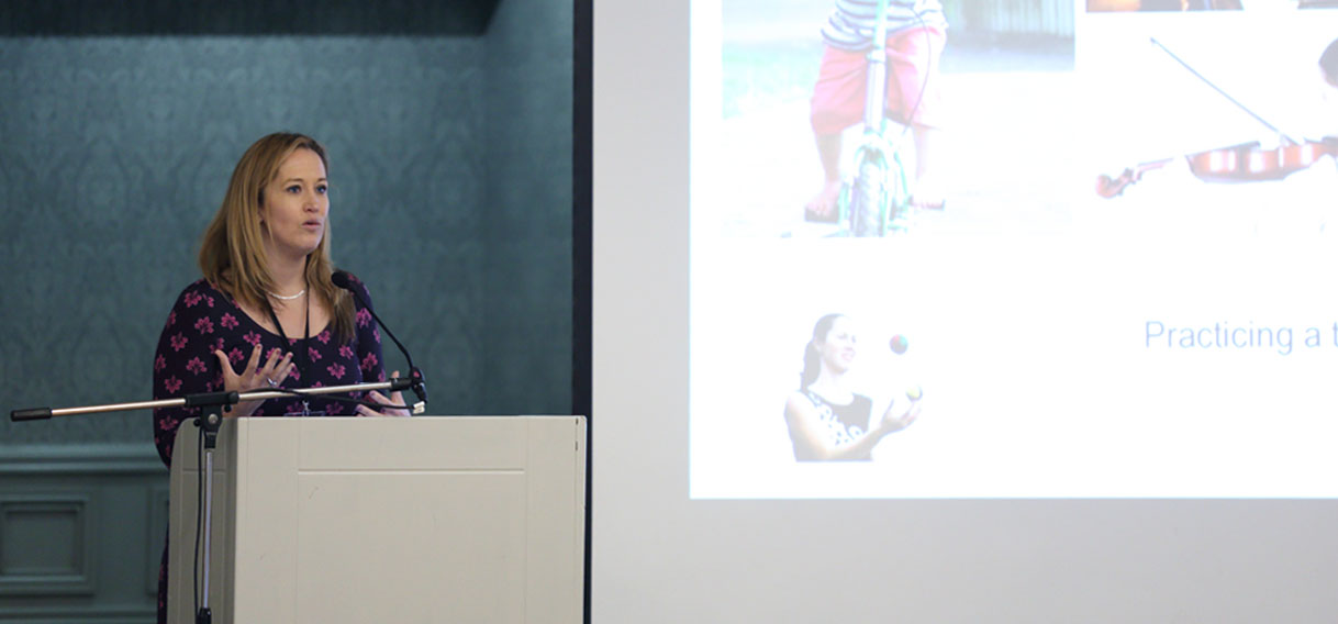 A speaker on the stage of the Northern Ireland Stroke Conference