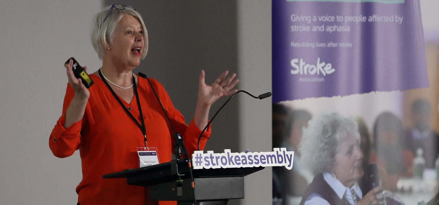 Photo of speaker on stage at the UK Stroke Assembly