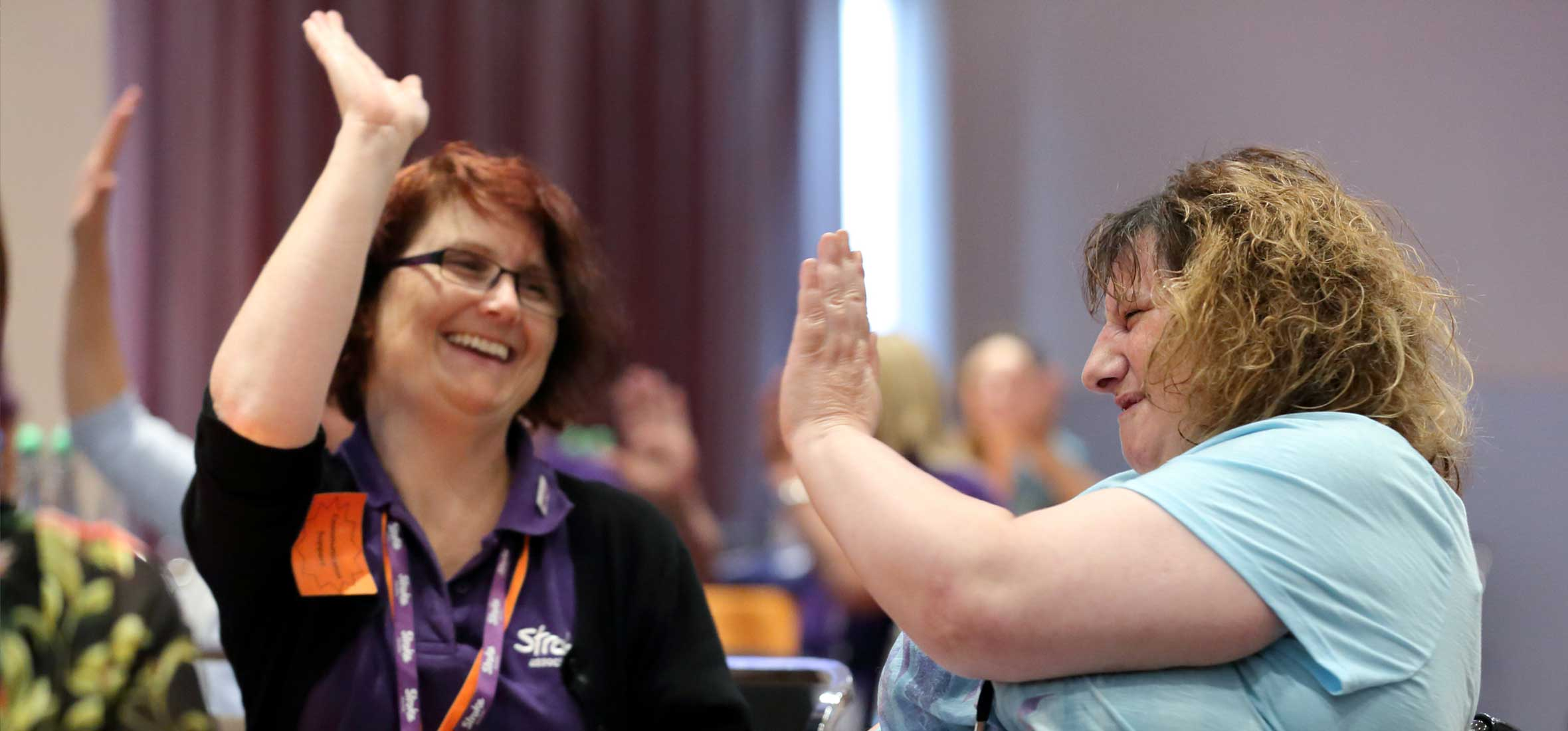 Photo of stroke survivor with Stroke Association's volunteer at the UK Stroke Assembly