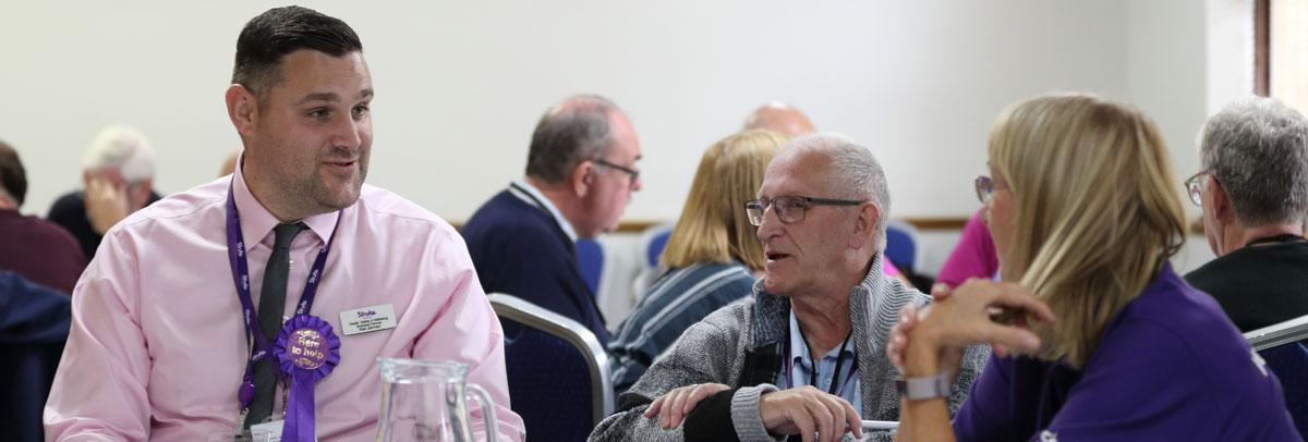 Photo of Neil Jermen talking to delegates at the UKSCC event