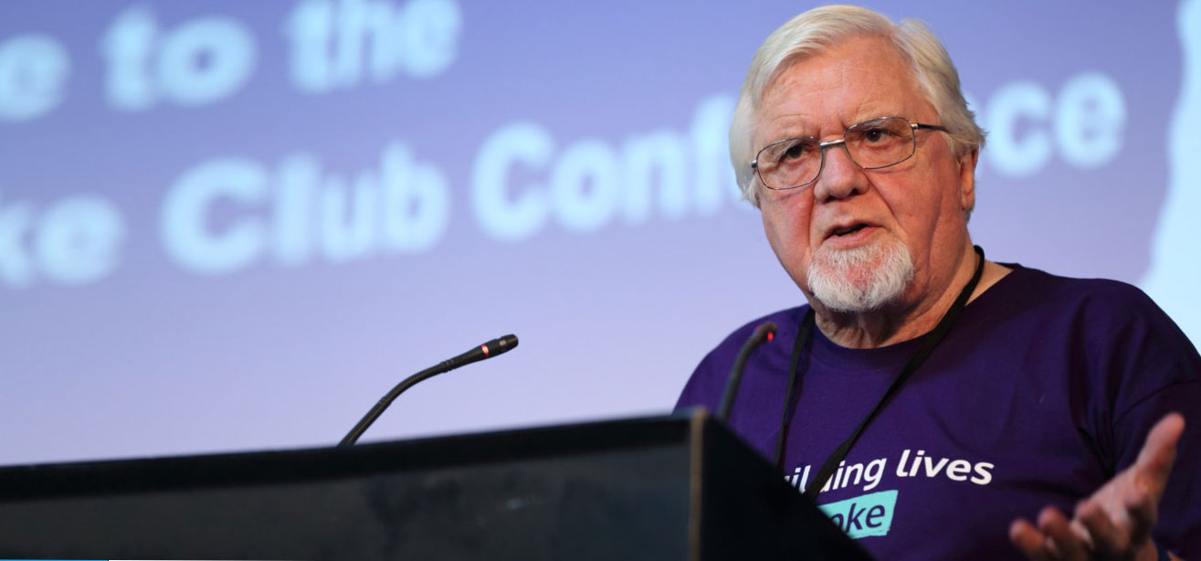Photo of Byran Hilton on podium at the UK Stroke Club Conference