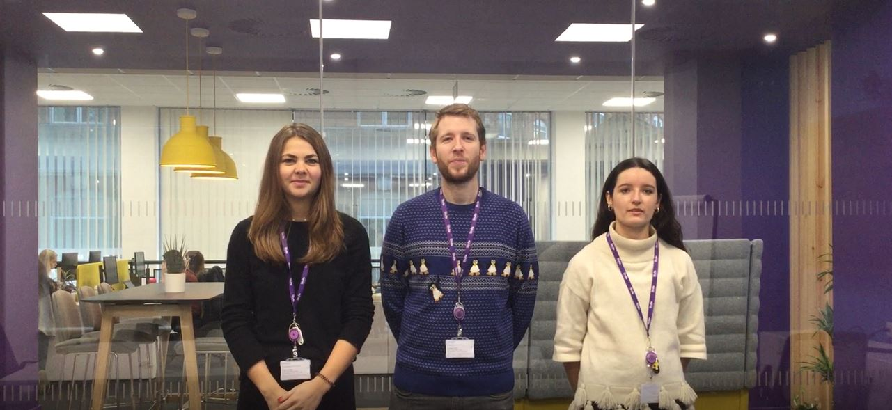 Three Stroke Association staff standing in the office