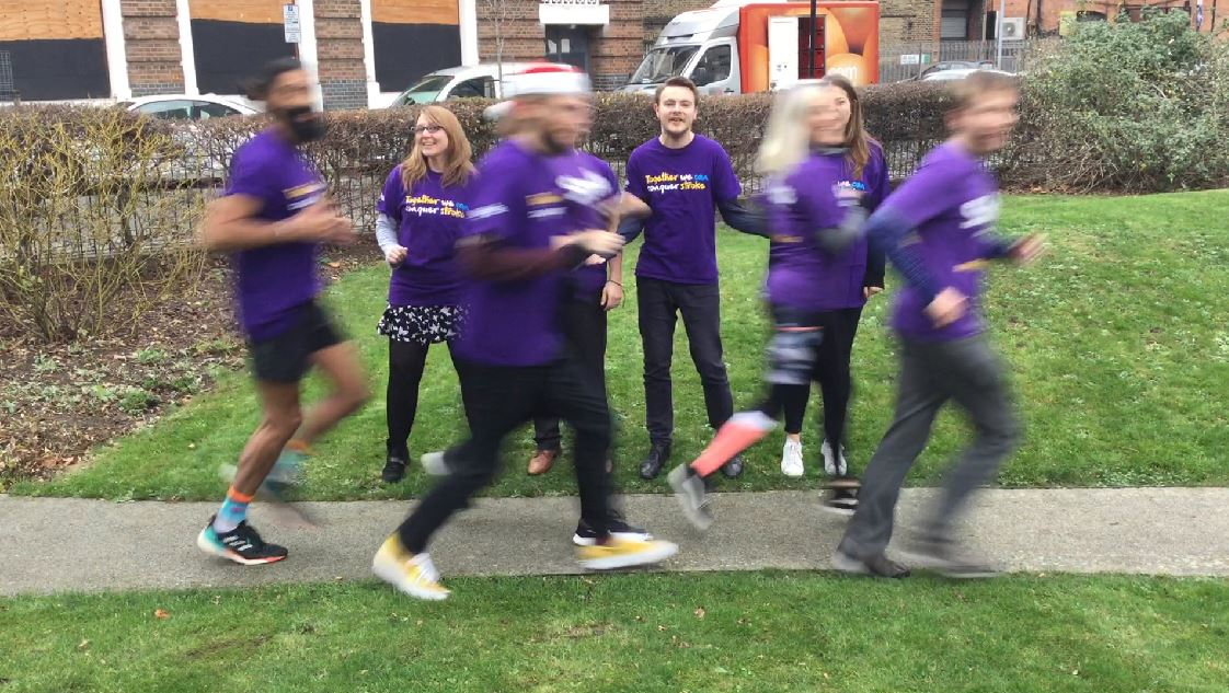 Stroke Association staff cheering on a group of runners
