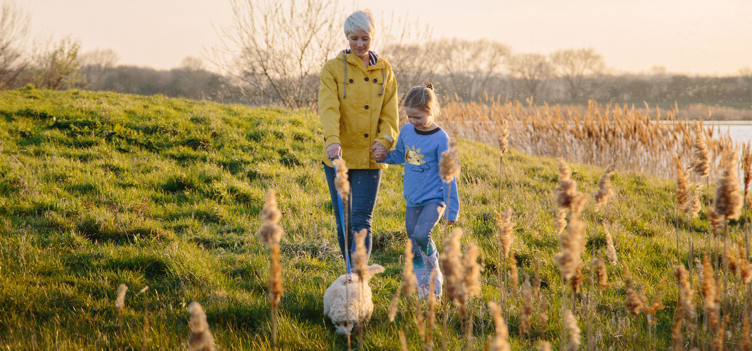 Image of mother and child walking in a field in support of the Stroke Association