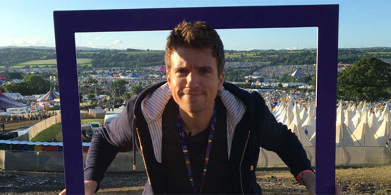 Greg James at Glastonbury, holding our sign