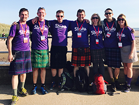 Stroke Association supporters wearing kilts, standing in a group