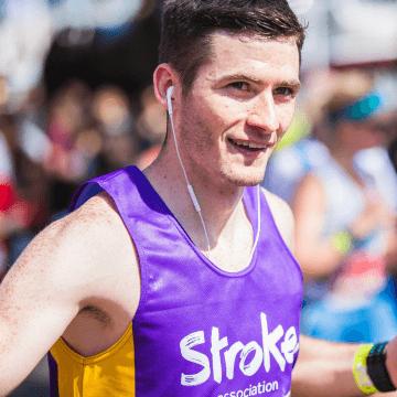 a marathon runner wearing headphones