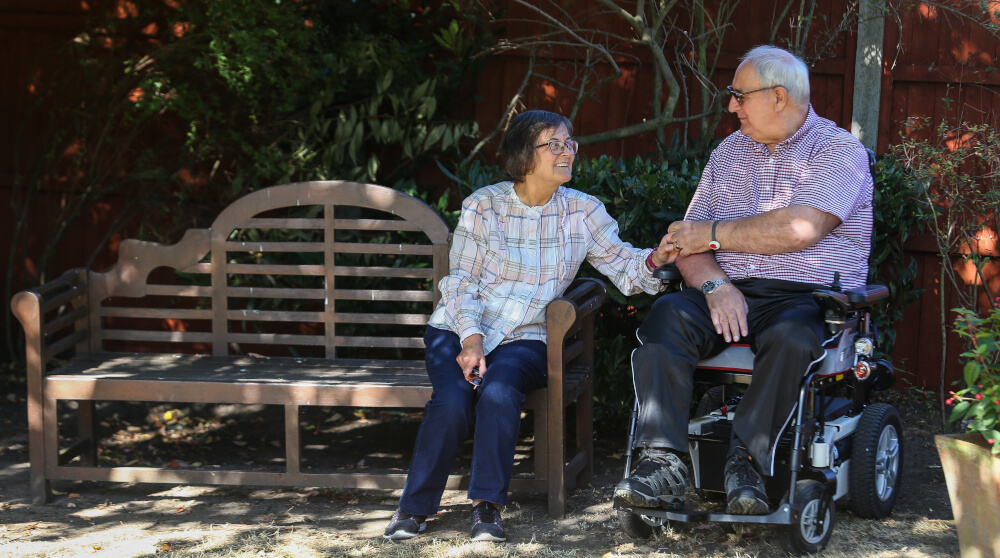 carer with husband in wheelchair