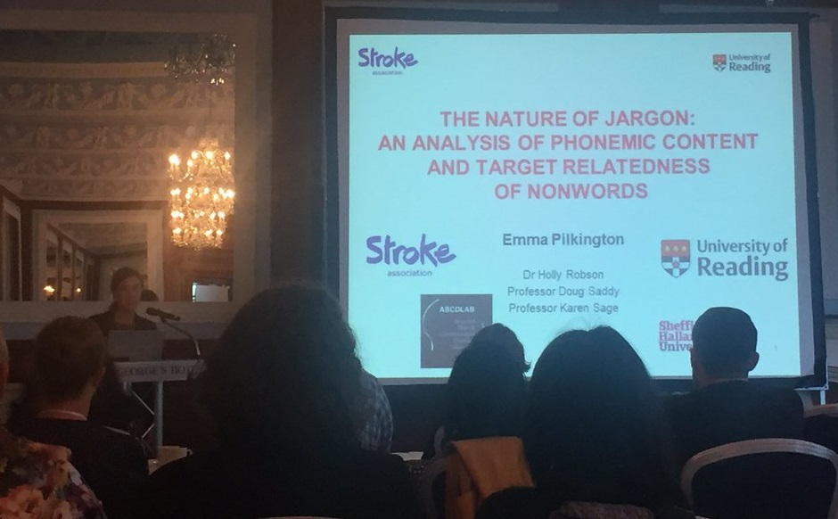 Ms Emma Pilkington standing at a podium, giving a presentation