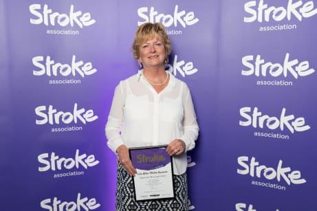 Professor Caroline Watkins holding her award
