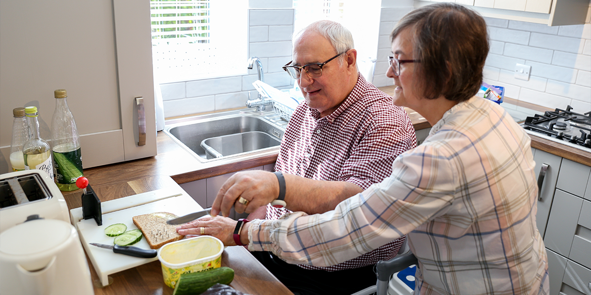 Image of a man and a woman cooking food