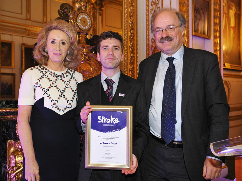 Dr Terry Quinn receiving award from Lady Estelle Wolfson and Professor Sir Mark Wolport for 'Joint Stroke Association / Chief Scientist Office Priority Programme Award'