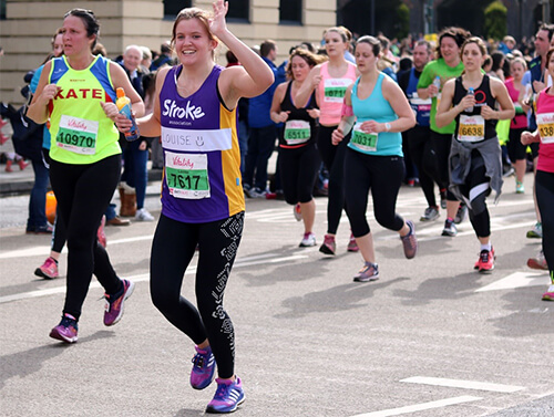 Photo of marathon runners fundraising for the Stroke Association
