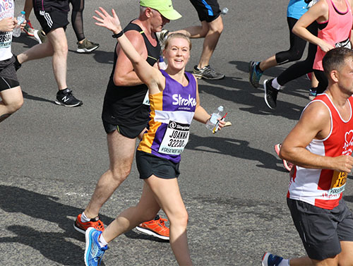 Great North Run event runner, waving at the viewer