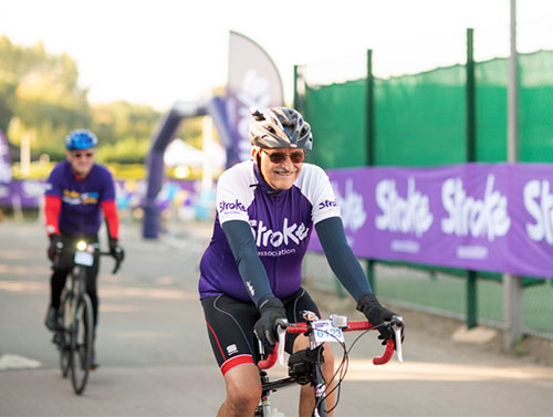 Sporting event bike rider wearing Stroke Association jersey
