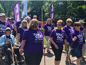 Group of people outside during Step Out for Stroke event