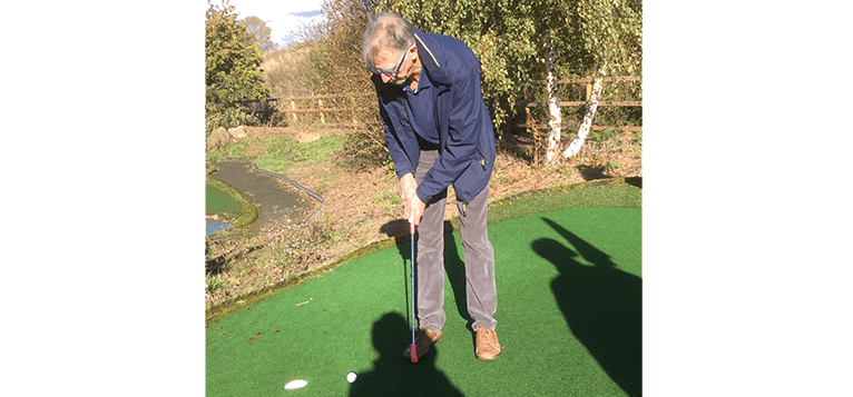 John Manning playing golf