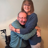 Peter and Jane hugging