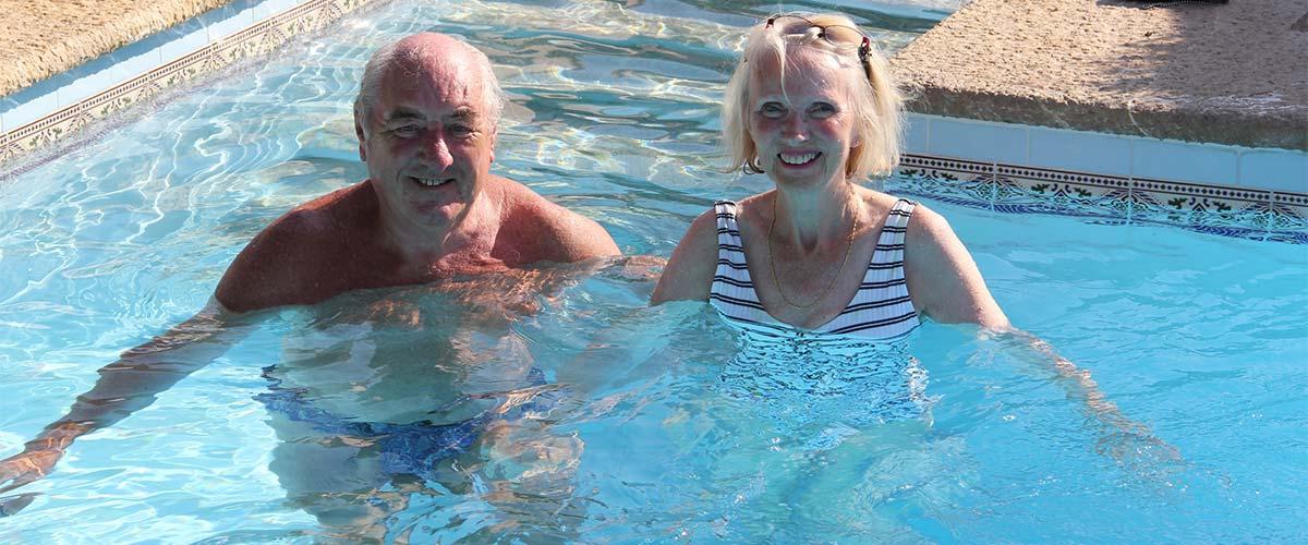 Tristan Maynard and wife in swimming pool