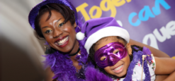 Photo of a Mum and daughter in purple costumes