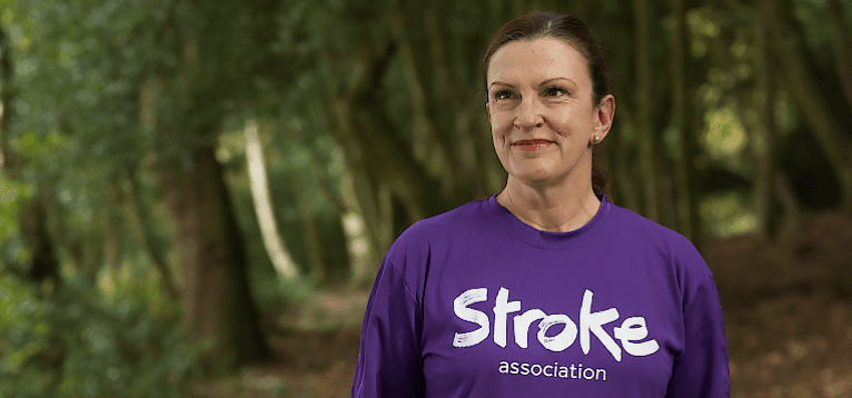 Allie Pugh dressed in a Stroke Association running top