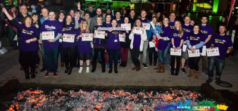 Fundraisers walk over hot coals for the Stroke Association