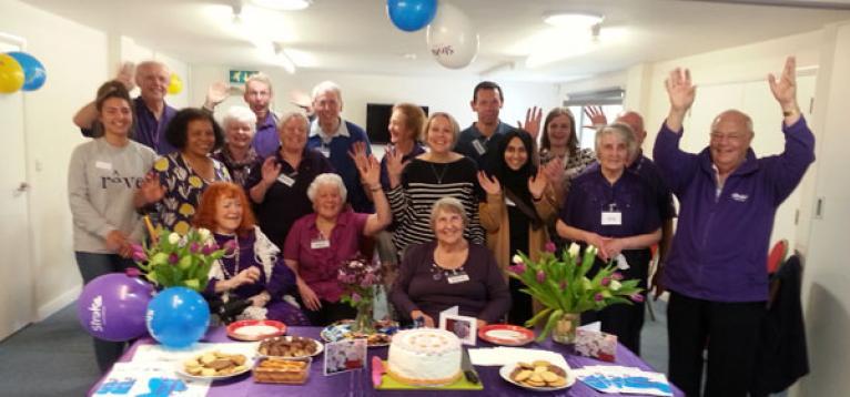 The group celebrating Make May Purple