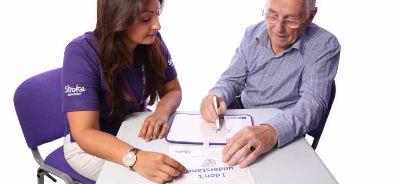 A stroke survivor receiving communication support from a Life After Stroke coordinator.