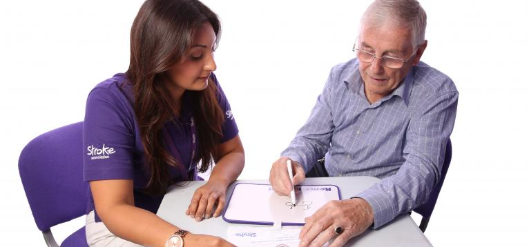 stroke survivor working with a coordinator using a communication aid