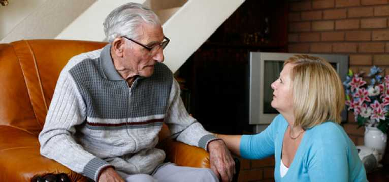 A stroke survivor and a carer together at home