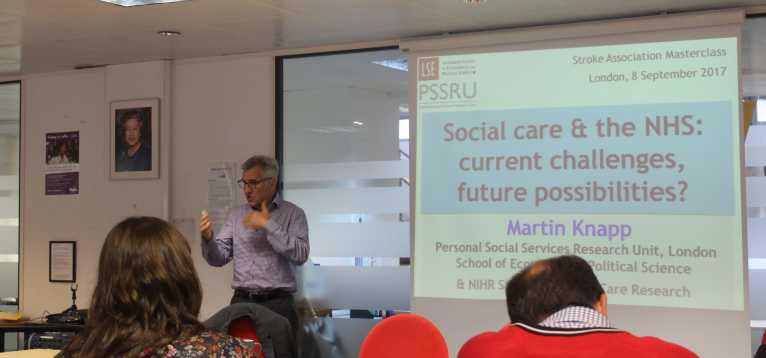Professor Martin Knapp standing up and instructing a workshop.