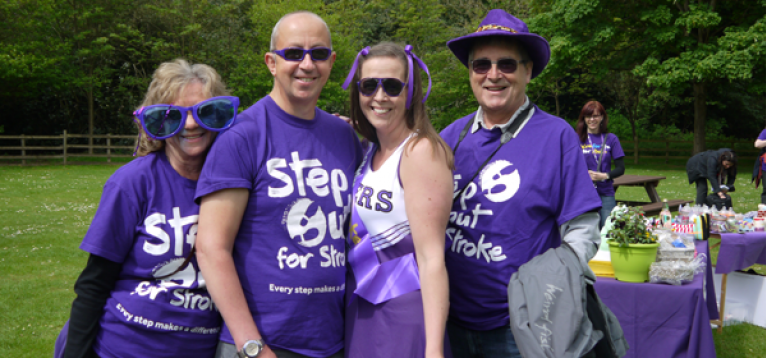 Supporters dressed up in purple outfits for Make May Purple