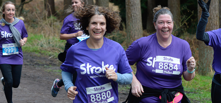 Resolution Run 2018 - Stroke Association runners on a path, smiling at the camera