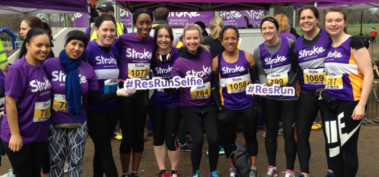 Runners in a line dressed in stroke association running gear ready to run
