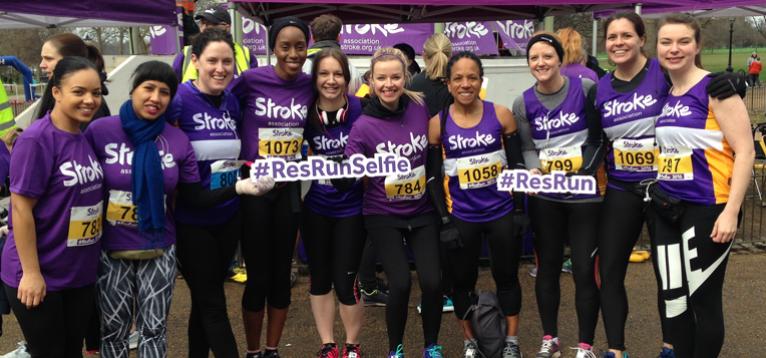Runners in a line dressed in stroke association running gear ready to run