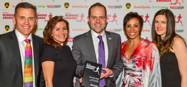 The Stroke Association Fundraising team at the running awards ceremony, holding their bronze trophy.