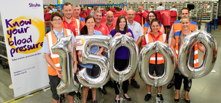 Royal Mail employees holding up 15,000 balloons
