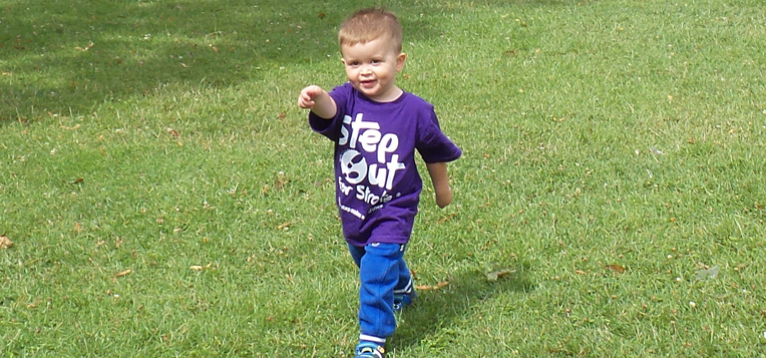 A little boy stepping out for stroke in Luton