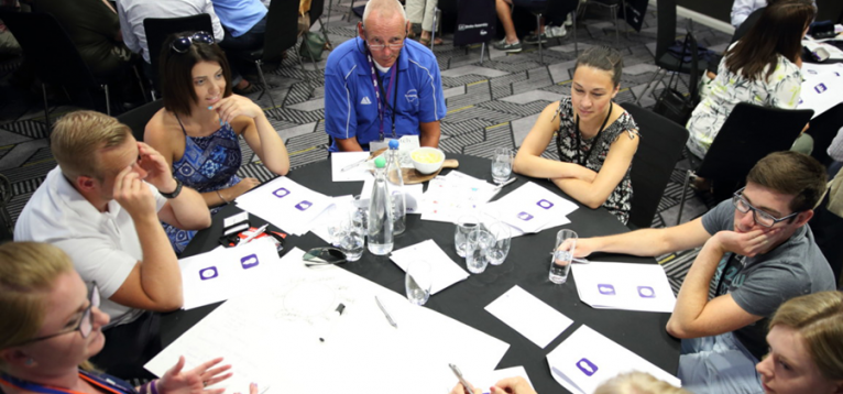 Group of people on a circular table at the UK Stroke Assembly