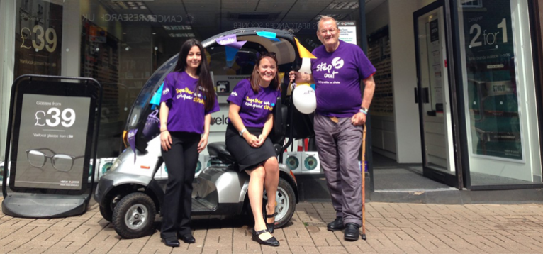 Vision Express staff outside their store in Stroke Association t-shirts