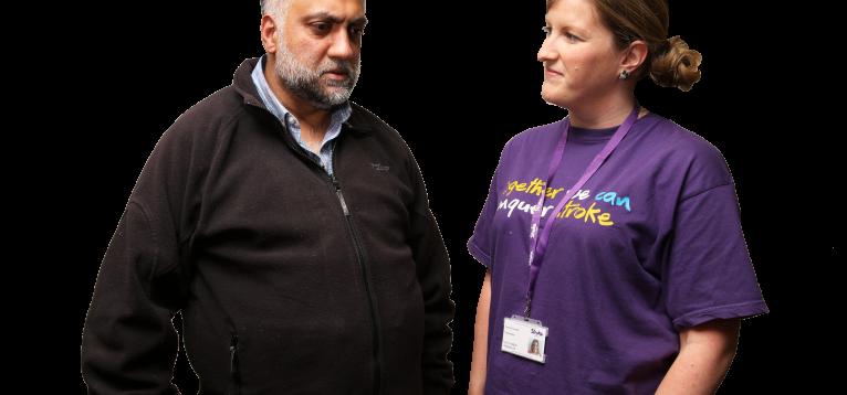 stroke survivor talking to a stroke association volunteer