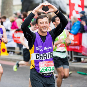London marathon runner with his hands making the shape of a heart