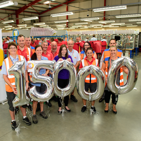 Royal mail employees celebrating reaching the milestone of delivering 15,000 blood pressure checks with the Stroke Association