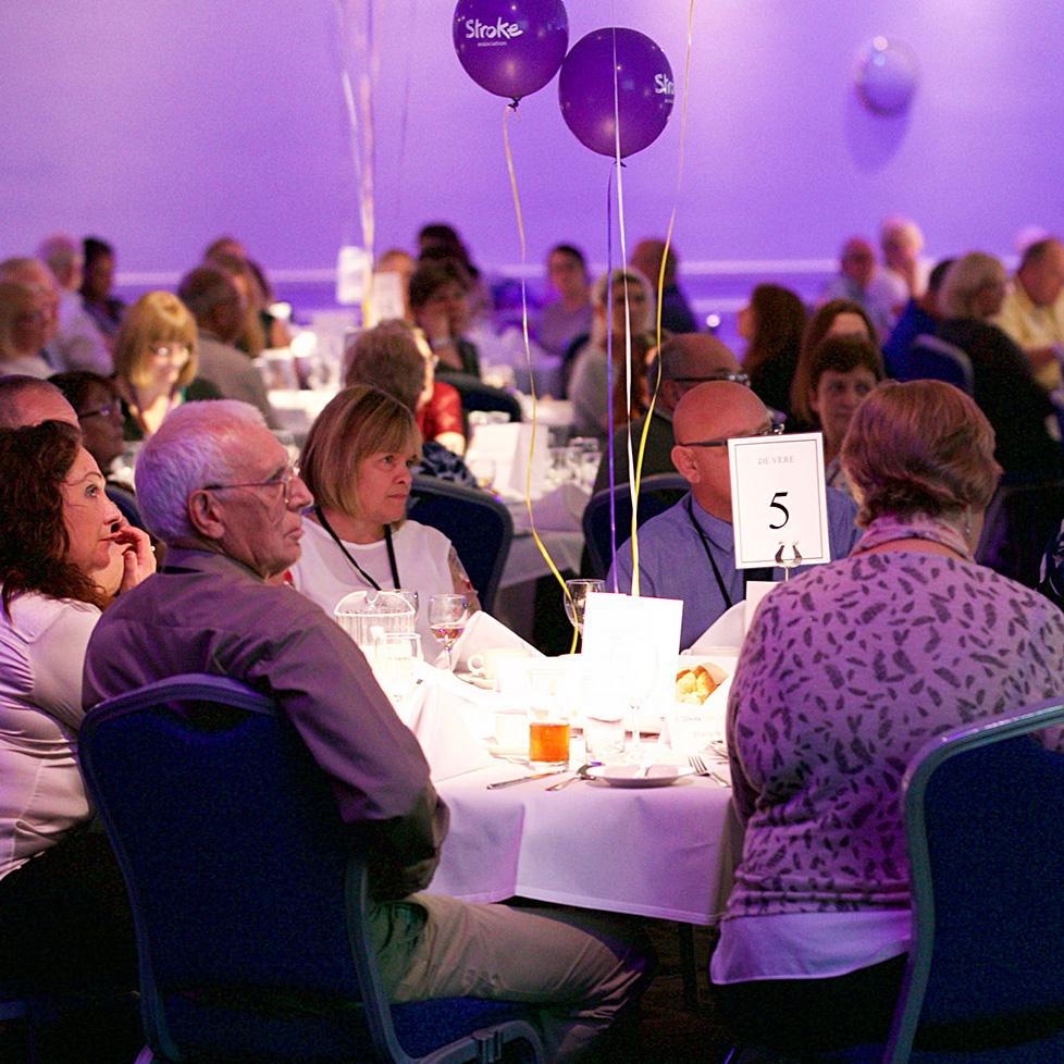 A group sits at a table during the 2017 UK Stroke Conference.