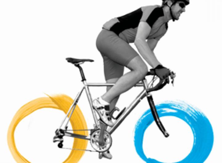 Fundraiser riding a bike
