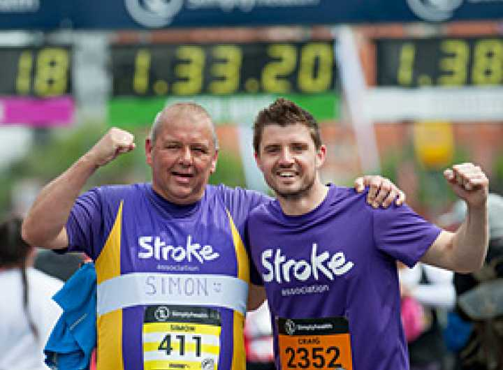 Two runners celebrating in stroke association t-shirts