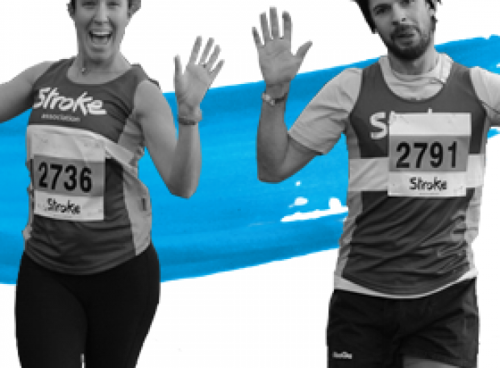 Two stroke association runners running with their hands up and smiling
